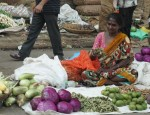 Woman selling vegetables on street in India