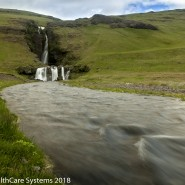 Green mountains and stream Iceland
