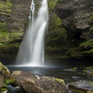 Waterfall and black rocks in Iceland